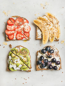 Healthy breakfast toasts with fruit  nuts and cream cheese