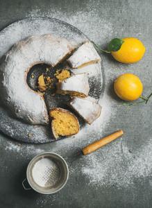 Homemade gluten free lemon bundt cake with sugar powder and sieve