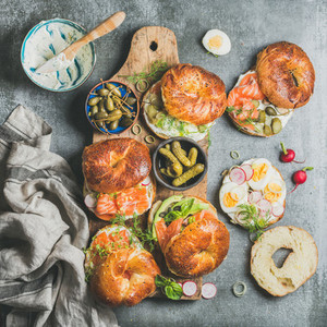 Variety of bagels with vegetables  salmon and cream cheese