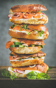 Heap of Bagels with salmon  eggs  vegetables  capers  cream cheese  herbs
