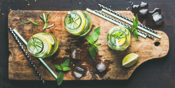 Dieting healthy infused citrus iced sassi water in glass bottles