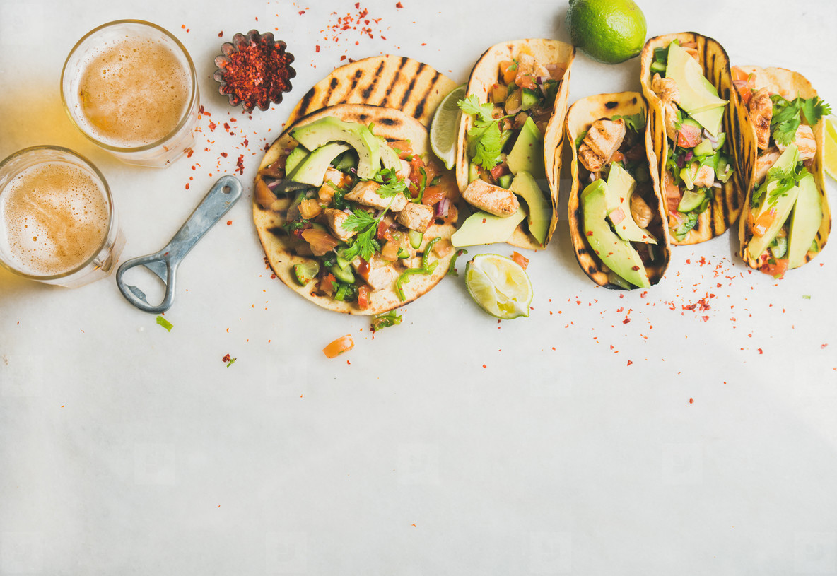 Healthy corn tortillas with grilled chicken  avocado  lime  beer