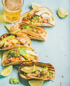 Corn chicken and avocado tortillas  beer in glass  copy space