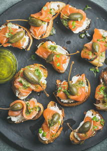 Homemade salmon crostini with cream cheese  watercress  capers  pesto suace
