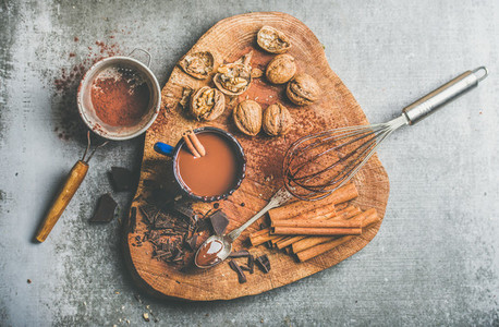 Rich hot chocolate with cinnamon and walnuts top view