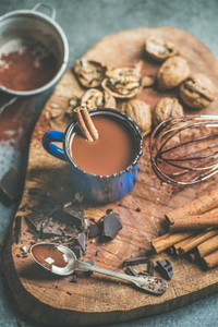 Making rich hot chocolate with cinnamon and walnuts