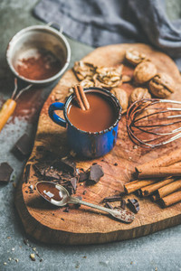 Making rich hot chocolate with cinnamon and walnuts on board