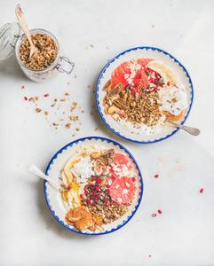 Healthy breakfast yogurt bowls with granola fresh and dried fruits