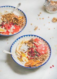 Healthy breakfast yogurt bowls over grey marble table background