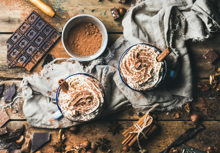 Hot chocolate with whipped cream  cinnamon  nuts and cocoa powder