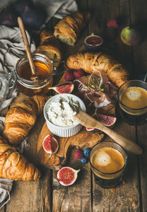 Breakfast with croissants  ricotta  figs  berries  prosciutto  honey and espresso