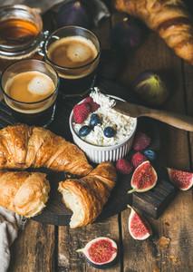 Breakfast with croissants  homemade ricotta  figs  fresh berries  honey  espresso