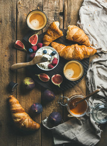 Breakfast with croissants  ricotta  figs  fresh berries  honey and espresso