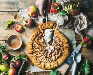 Man039 s hand holding piece of apple crostata pie