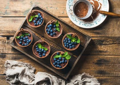 Homemade Tiramisu dessert and sieve with cocoa powder in tray