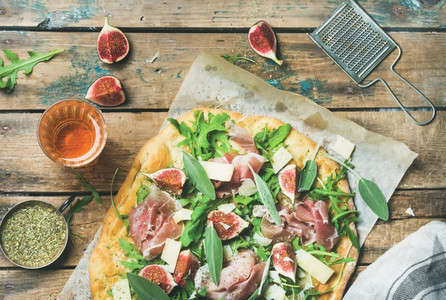 Fig  prosciutto  arugula  sage flatbread pizza and rose wine