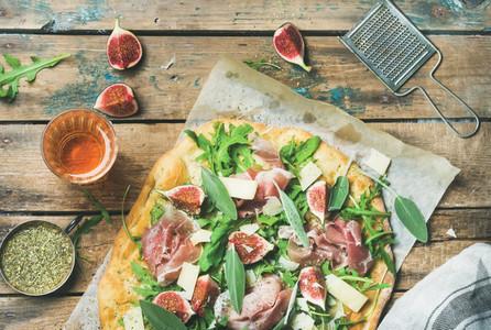 Fig  prosciutto  arugula  sage flatbread pizza and rose wine