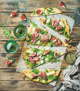 Homemade sage flatbread pizza cut into pieces with rose wine