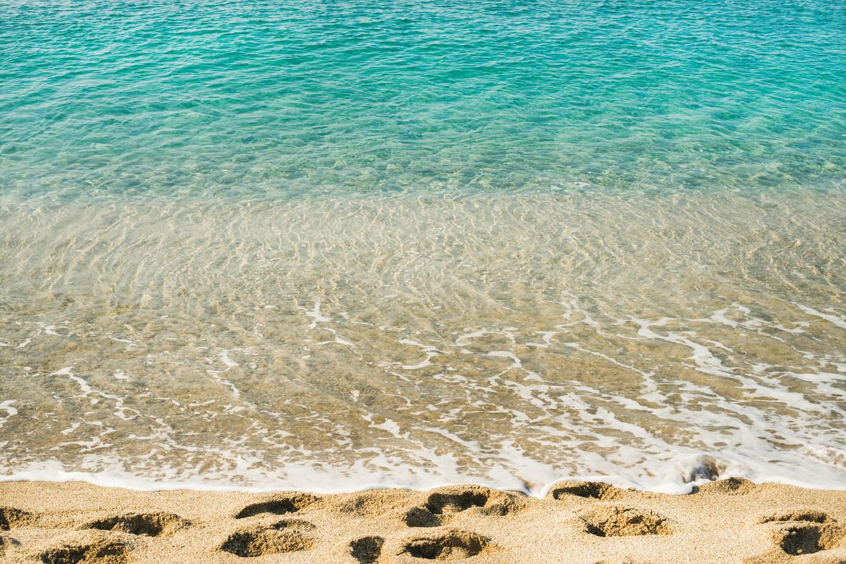 Clear water and footprints at Cleopatra beach  Alanya  Turkey