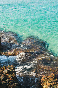Natural rocks and clear blue waters at Kleopatra beach Alanya