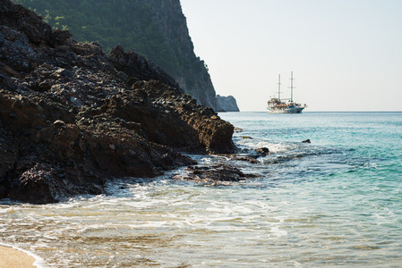 Natural rocks and passenger ship sailing on Mediterranean sea  Alanya