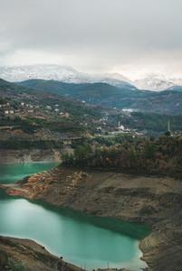 Landscape with green Dim Cay storage pond in mountains  Turkey
