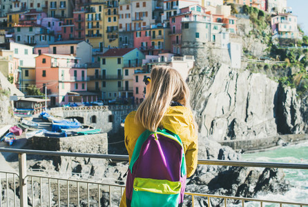 Young blond tourist woman in Riomaggiore  Cinque Terre  Italy