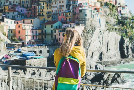 Young blond tourist woman in Riomaggiore  Cinque Terre  Italy