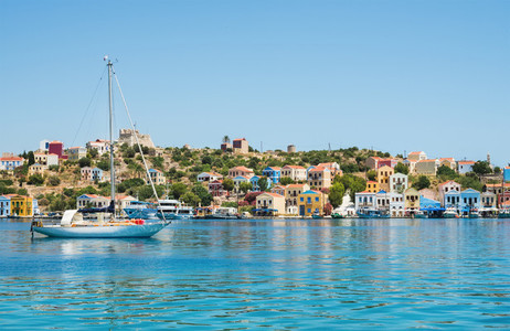 Island coast with colorful houses clear sea water yacht Greece