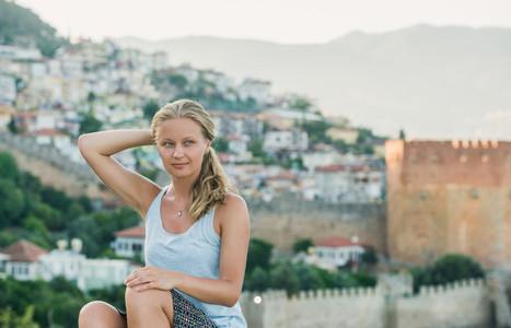 Young woman sitting and looking at horizon  Alanya  Turkey
