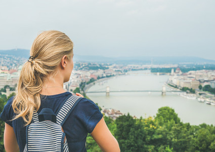 Young woman traveler looking at Danube river  Budapest  Hungary