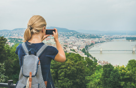 Young woman making photoes of Danube river and Budapest  Hungary