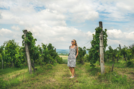 Young woman standing at Tihany wineyards Hungary
