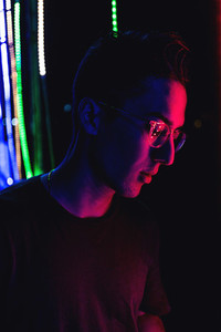 Man illuminated by neon light