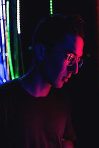 Man illuminated by neon light