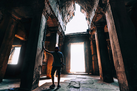 Man standing in ancient ruins