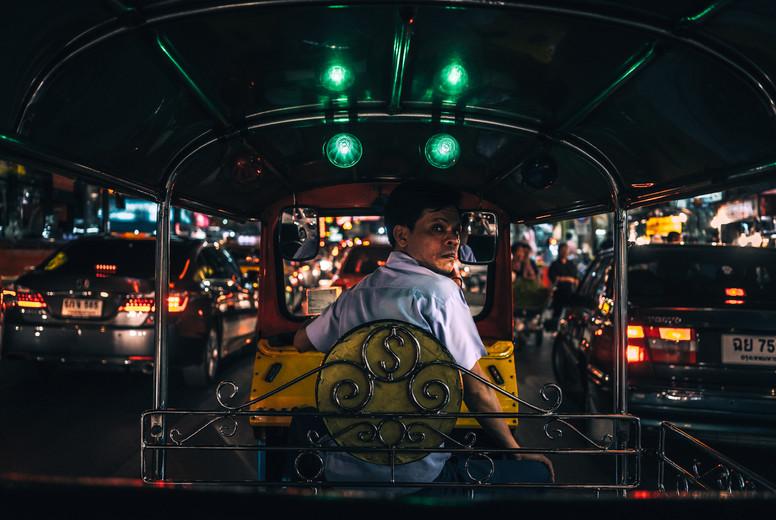 Tuk Tuk driver looks behind