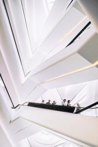 People on a modern escalator 1