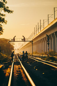 Peoples crossing a railroad