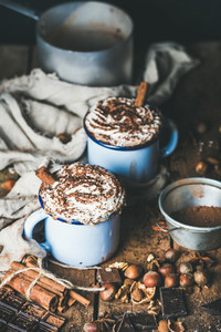 Hot chocolate with whipped cream  cinnamon sticks and nuts