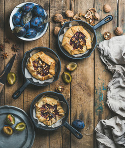 Slow food concept with plum and walnut crostata pie