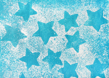 Star shaped biscuits silhouettes over bright blue background