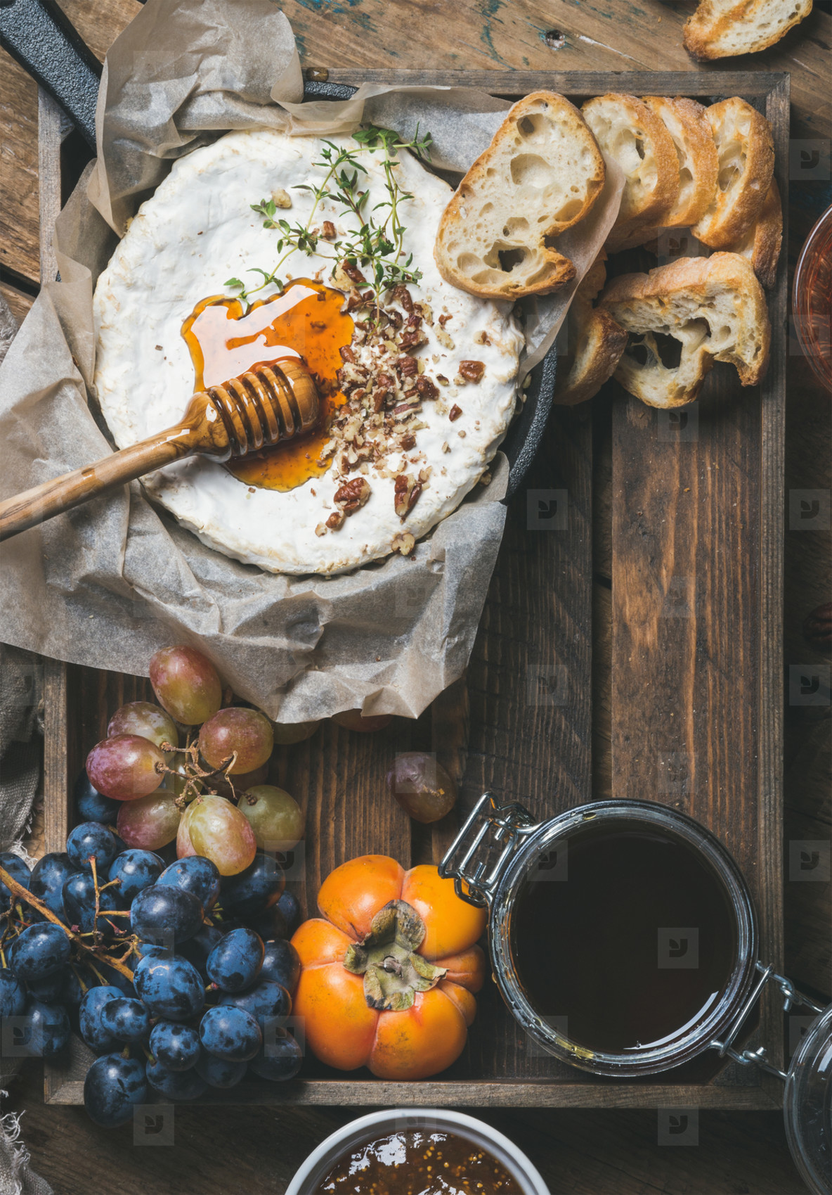 Cheese  fruit and wine set over wooden background  copy space