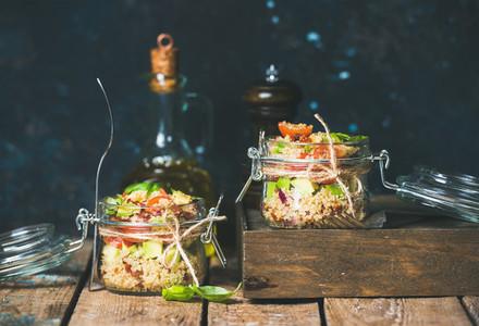 Homemade quinoa salad with cherry and sun dried tomatoes  avocado  basil