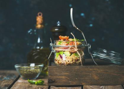 Healthy homemade jar quinoa salad with sun dried tomatoes  avocado  basil