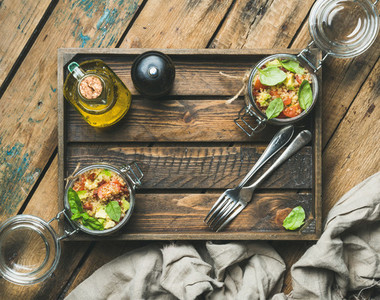 Homemade quinoa salad with cherry tomatoes  avocado  fresh basil in box