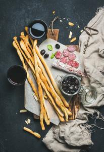 Italian Grissini bread sticks  dry cured pork sausage  red wine