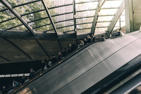 People riding down an escalator