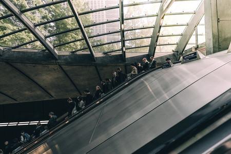 People riding down an escalator
