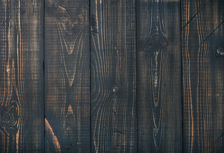 Old dark scorched wood texture  wallpaper or background